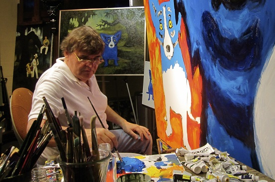 George Rodrigue painting the blue dog