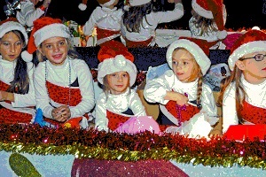 Children on floats at New Iberia Christmas parade