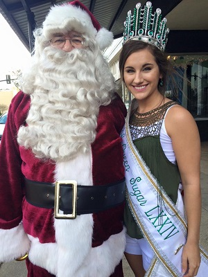 Queen sugar with Santa Claus during New Iberia Christmas parade