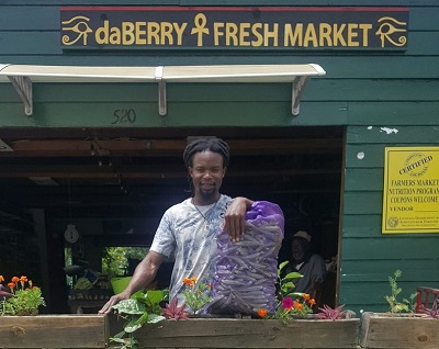 Carl Cooper Jr selling okra at Da Berry Fresh Market - Photo by  Da Berry Fresh Market
