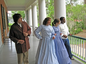 Reenactors in period dress at Shadows on the Teche plantation home in New Iberia Louisiana