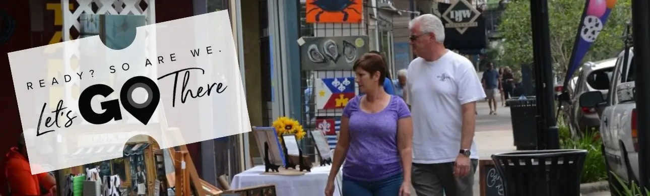 Couple looking at art booth in New Iberia Historic District
