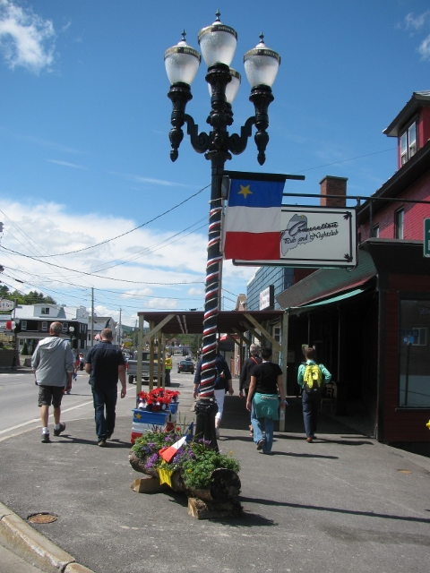 Flag in decorated street at Congres Mondial Acadien